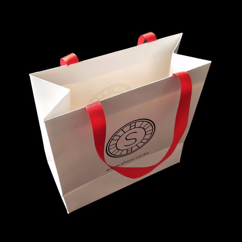 White 300 Gsm Matte Paper Shopping Bags Matte Lamination With Ribbon Handle supplier